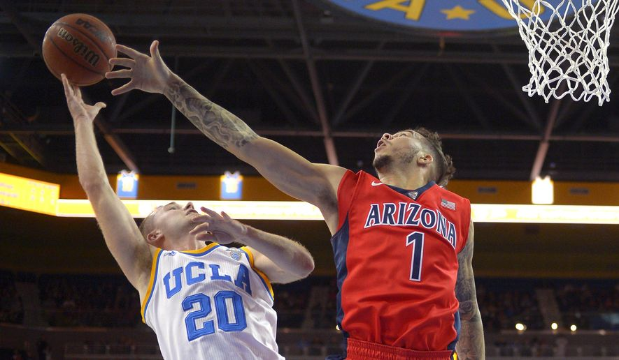 UCLA guard Bryce Alford, left, shoots as Arizona guard Gabe York defends during the first half of an NCAA college basketball game, Thursday, Jan. 7, 2016, in Los Angeles. (AP Photo/Mark J. Terrill)