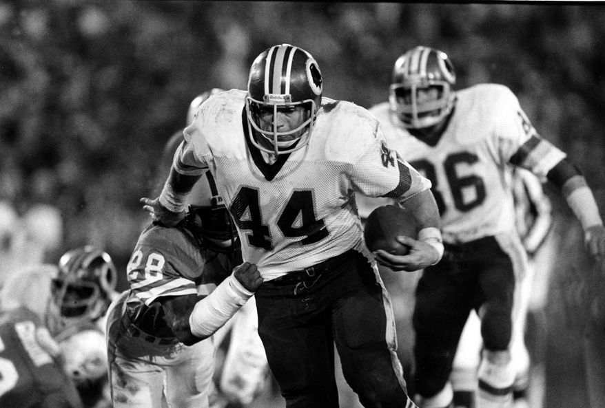 Washington Redskins running back John Riggins (44) eludes tackle by Don McNeal (28), of the Miami Dolphins, for gain during Sunday night's Super Bowl XVII game in the Rose Bowl in Pasadena, Ca., on Jan. 30, 1983.  Riggins, named the game's Most Valuable Player, rushed for 166 yards, a Super Bowl record.  The Redskins beat the Miami Dolphins 27-17.  (AP Photo)