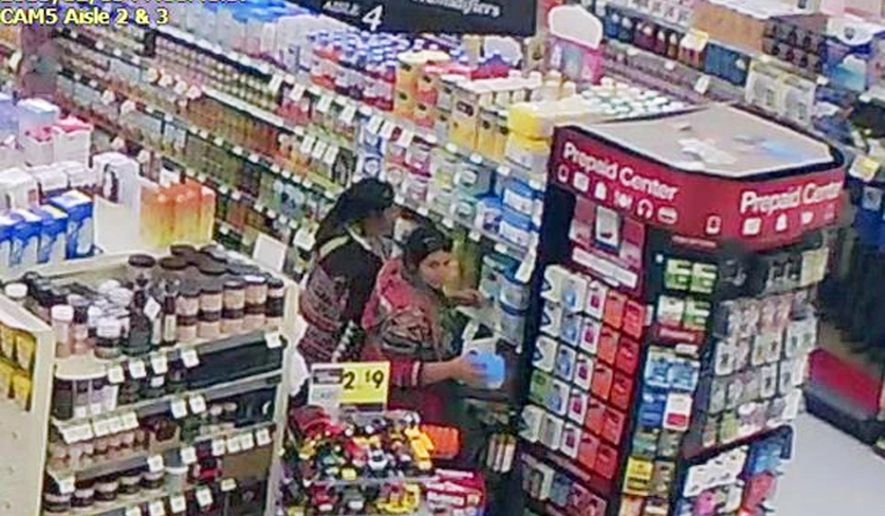 This Dec. 5, 2015 store surveillance video released by the Logan, Utah, Police Department shows women police say were shoplifting baby formula from a store in Logan. Police say they've arrested two women and a man they believe stole more than $5,200 worth of baby formula and a few other items from northern Utah stores. Logan Police Capt. Curtis Hooley says the three were arrested Monday, Dec. 28, 2015 and are being held in the Cache County jail on suspicion of theft and other charges.(Logan Police Department via AP)