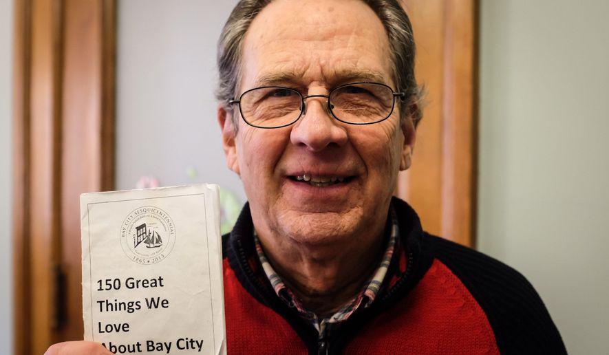 "Contest winner Taylor Langstaff poses in Bay City, Mich., on Thursday, Jan. 7, 2016. Langstaff won prizes worth nearly $2,000 after being the only person to enter a contest to celebrate a Bay City's 150th anniversary. Langstaff had to do 25 activities in the Bay City area and stamp them off on a ""passport"" to win the prizes, MLive.com reported. He was the only person to submit a fully-stamped passport. (Andrew Dodson /The Bay City Times via AP) LOCAL TELEVISION OUT; LOCAL INTERNET OUT; MANDATORY CREDIT"