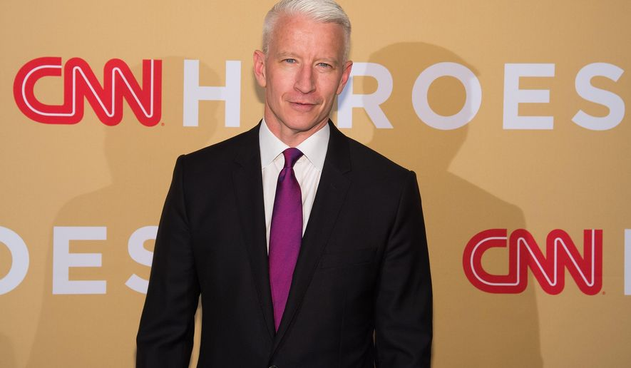 In this Nov. 17, 2015 file photo, Anderson Cooper attends CNN Heroes: An All-Star Tribute in New York. A joint memoir by Anderson Cooper and Gloria Vanderbilt will be published on April 5, just days before the airing of an HBO documentary featuring the famous designer-socialite and her CNN anchor-son. (Photo by Charles Sykes/Invision/AP/File)