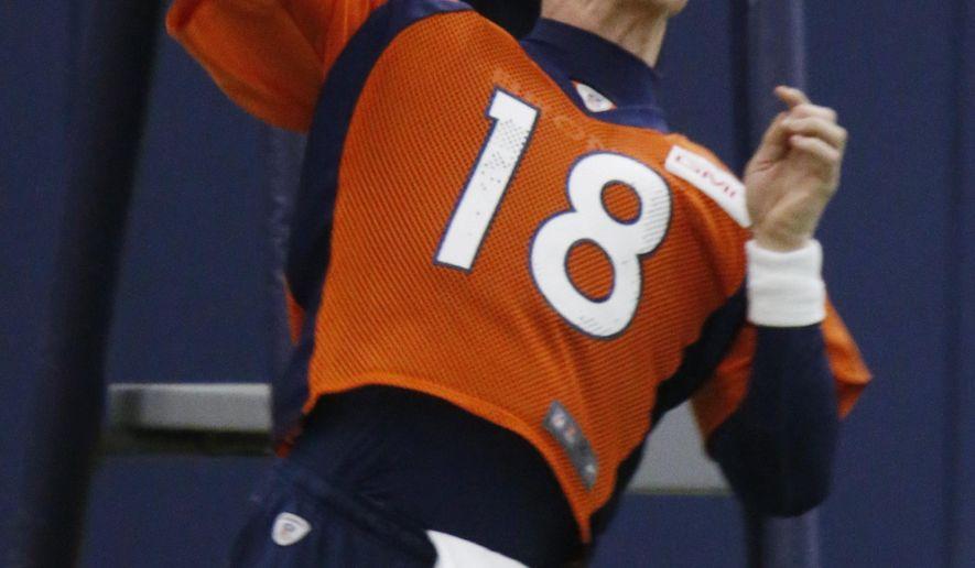 Denver Broncos quarterback Peyton Manning throws during the team's NFL football practice Thursday, Jan. 7, 2016, in Englewood, Colo. (AP Photo/David Zalubowski)