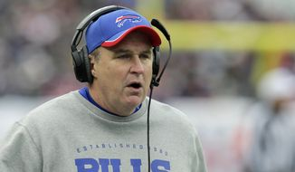 FILE - In this Dec. 28, 2014, file photo, then-Buffalo Bills head coach Doug Marrone speaks to an official on the sideline in the first half of an NFL football game against the New England Patriots, in Foxborough, Mass.  (AP Photo/Charles Krupa, File) **FILE**