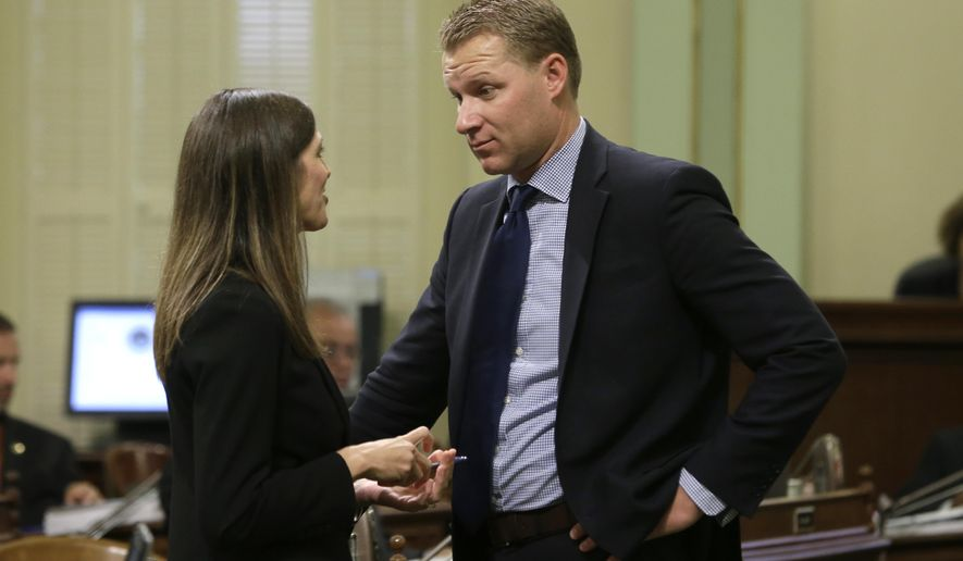 FILE -- In this Sept. 10, 2015 file photo, Assembly Minority Leader Kristin Olsen, R-Riverbank, talks with Assemblyman Chad Mayes, R-Yucca Valley, at the Capitol Thursday, Sept. 10, 2015, in Sacramento, Calif. Mayes, who has been elected to replace Olsen as Minority Leader, is urging Gov. Jerry Brown to hold the line on excessive state spending and to devote funds to neglected infrastructure needs.  Brown is expected to unveil his 2016-17 state budget proposal Thursday.(AP Photo/Rich Pedroncelli,file)