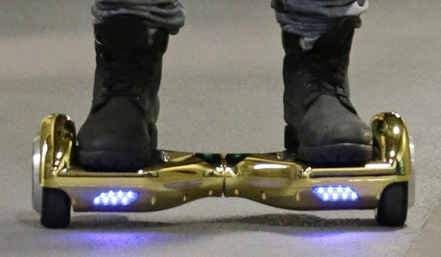 """FILE - In this Oct. 5, 2015 file photo, Seattle Seahawks wide receiver B.J. Daniels rides through a hallway at CenturyLink Field on an electric self-balancing scooter commonly called a """"hoverboard,"""" as he arrives for an NFL football game against the Detroit Lions in Seattle. Since December 2015, several universities have banned or limited hoverboards on their campuses, saying the two-wheeled, motorized scooters are unsafe. Beyond the risk of falls and collisions, colleges are citing warnings from federal authorities that some of the self-balancing gadgets have caught on fire. (AP Photo/Elaine Thompson, File)"""