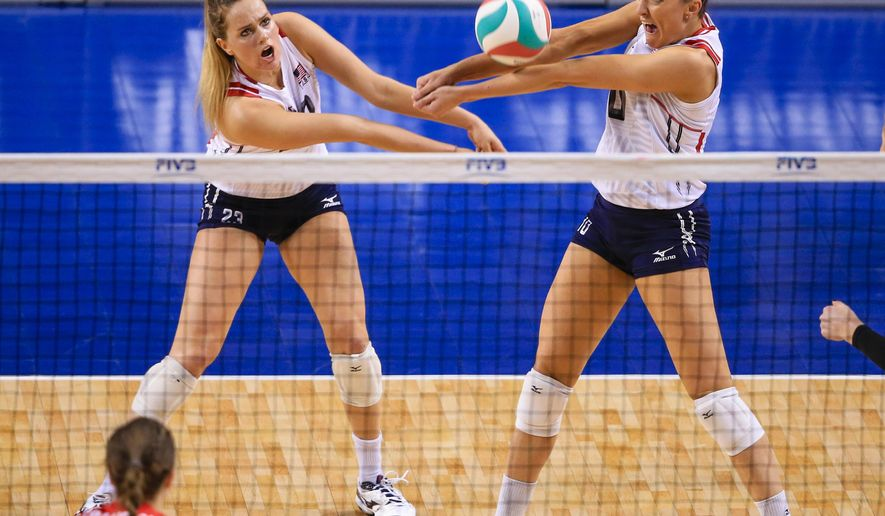 United States' Jordan Larson-Burbach (10) and Kelsey Robinson, left, go for a dig as Canada's Dana Cranston (20) watches, in a women's volleyball NORCECA round-robin Olympic qualifying tournament match in Lincoln, Neb., Thursday, Jan. 7, 2016. (AP Photo/Nati Harnik)