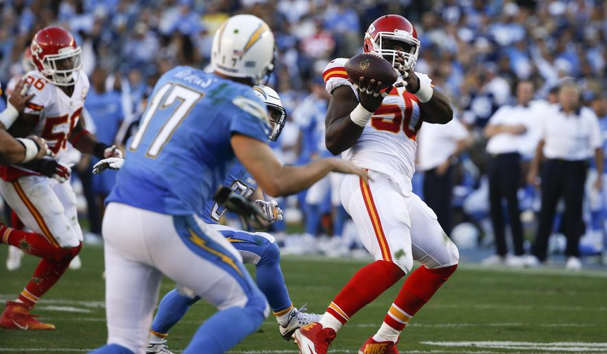 FILE - In this  Sunday, Nov. 22, 2015 file photo, Kansas City Chiefs outside linebacker Justin Houston (50) intercepts a pass thrown by San Diego Chargers quarterback Philip Rivers (17) during the second half of an NFL football game in San Diego. Houston scored a touchdown on the play. (AP Photo/Lenny Ignelzi, File)