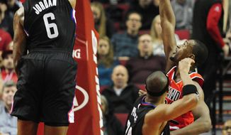 Los Angeles Clippers center DeAndre Jordan (6) blocks the shot of Portland Trail Blazers forward Maurice Harkless (4) during the first half of an NBA basketball game in Portland, Ore., Wednesday, Jan. 6, 2016. (AP Photo/Steve Dykes)