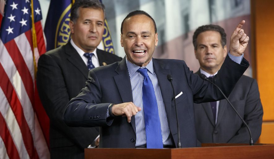 Democratic Reps. Luis Gutierrez (center) of Illinois, Juan Vargas (left) of California and David Cicilline of Rhode Island hold a news conference on Capitol Hill in Washington on Jan. 13, 2015. (Associated Press) **FILE**