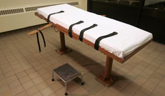 "FILE - This November 2005 file photo shows the death chamber at the Southern Ohio Correctional Facility in Lucasville, Ohio. As Ohio sought to justify its reasoning for shielding the names of people or companies providing lethal drugs to the prison system, it paid a security consultant who determined that identifying the suppliers would put them at risk of ""harm, violence or unlawful acts of intimidation,"" according to newly released documents. (AP Photo/Kiichiro Sato, File)"