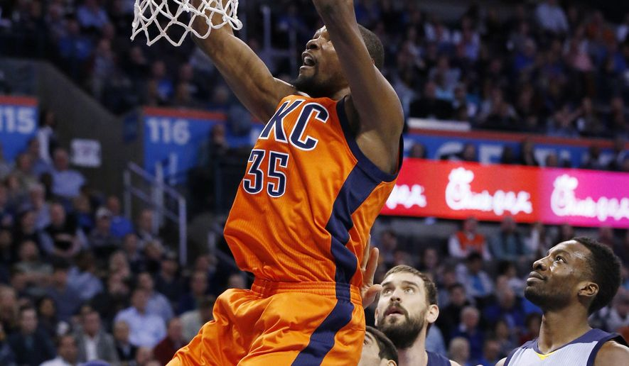 Oklahoma City Thunder forward Kevin Durant (35) dunks in front of Memphis Grizzlies forward Zach Randolph, left, and forward Jeff Green, right, during the first quarter of an NBA basketball game in Oklahoma City, Wednesday, Jan. 6, 2016. (AP Photo/Sue Ogrocki)