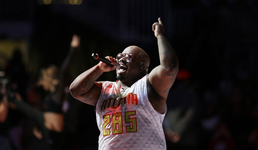 FILE - In this Saturday, Dec. 26, 2015 file photo, entertainer Cee Lo Green performs during halftime of an NBA basketball game between the Atlanta Hawks and the New York Knicks in Atlanta. The Hawks are collaborating with big-name hip-hop artists like Green, T.I., Ludacris and Big Boi in what the team calls an effort to make amends after it was revealed two officials made racially charged remarks in separate incidents. (AP Photo/David Goldman, File)