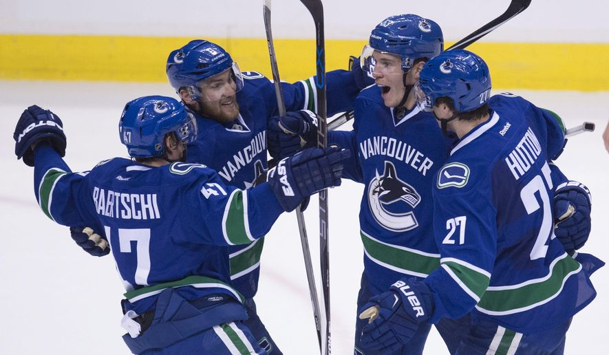 Vancouver Canucks center Bo Horvat (53) celebrates his goal against the Carolina Hurricanes with his teammates during the third period of an NHL hockey game Wednesday, Jan. 6, 2016, in Vancouver, British Columbia. (Jonathan Hayward/The Canadian Press via AP)
