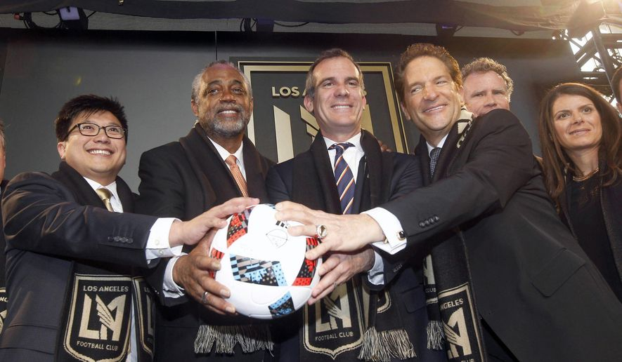 Celebrating the introduction of the new Los Angeles Football Club's logo and colors are, from left, managing partner Henry Nguyen, L.A. City Councilman Curren Price, Mayor Eric Garcetti, Peter Guber, and Mia Hamm Garciaparra, during the new soccer club's news conference in Los Angeles Thursday, Jan. 7, 2016. (AP Photo/Nick Ut)