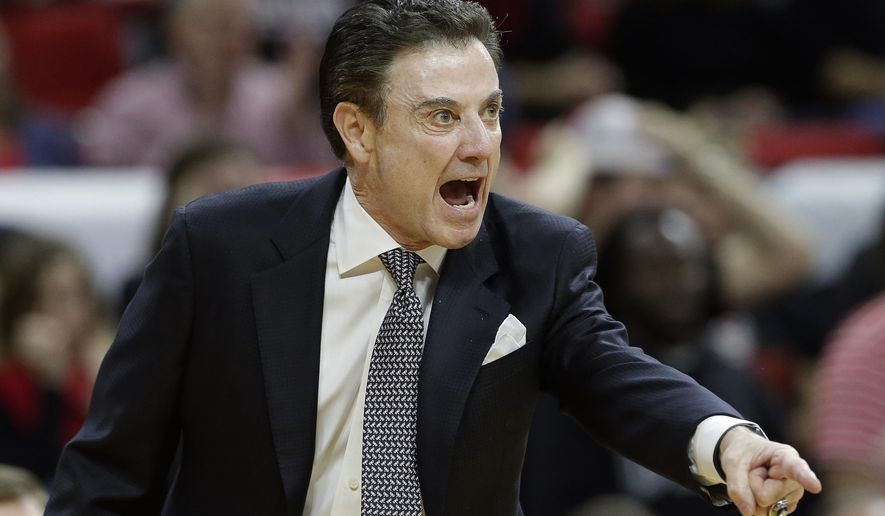 Louisville coach Rick Pitino yells during the first half of an NCAA college basketball game against North Carolina State in Raleigh, N.C., Thursday, Jan. 7, 2016. (AP Photo/Gerry Broome)