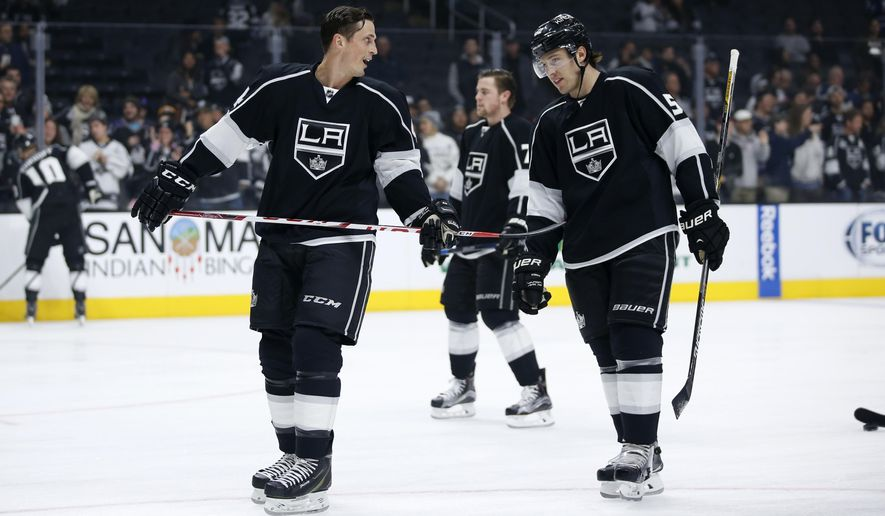 Newly acquired Los Angeles Kings center Vincent Lecavalier, left, and defenseman Luke Schenn, right, talk as players warm up for an NHL hockey game against the Toronto Maple Leafs, Thursday, Jan. 7, 2016, in Los Angeles. The Kings acquired Lecavalier and Schenn from Philadelphia in a trade on Wednesday. Lecavalier intends to retire after the season, and he wants to end his 17-year NHL career with one last run at the Stanley Cup. (AP Photo/Danny Moloshok)