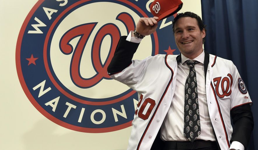 New Washington Nationals infielder Daniel Murphy poses for a photo during a news conference at Nationals Park in Washington, Thursday, Jan. 7, 2016. Murphy's three-year contract with the Nationals will cost the team only $8 million in 2016. (AP Photo/Susan Walsh)