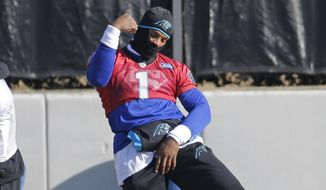 Carolina Panthers' Cam Newton (1) dances to music playing over loudspeakers as players stretch during practice for the NFL football team in Charlotte, N.C., Thursday, Jan. 7, 2016. (AP Photo/Chuck Burton)