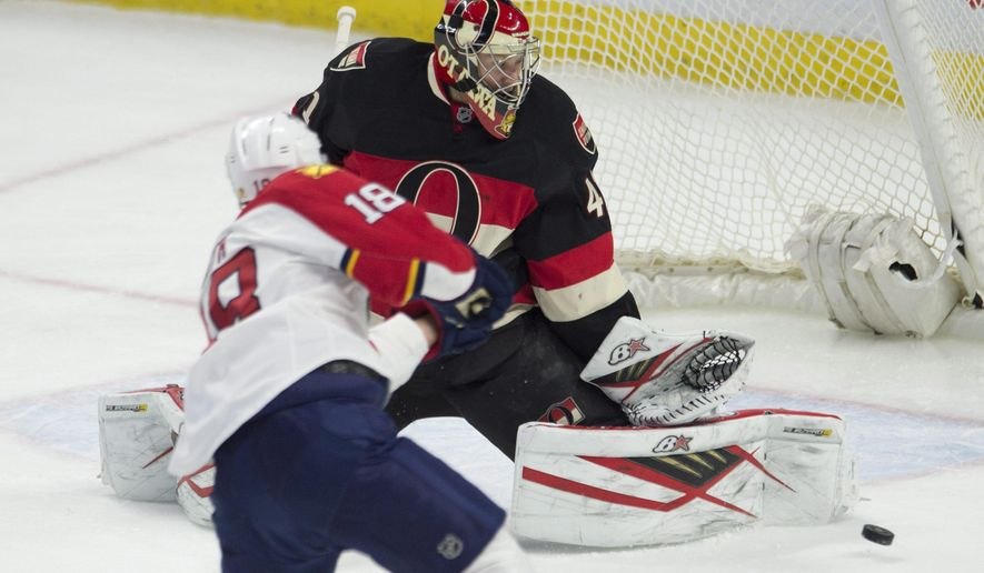 Ottawa Senators goalie Craig Anderson watches a shot from Florida Panthers right wing Reilly Smith go wide of the net during the first period of an NHL hockey game Thursday, Jan. 7, 2015, in Ottawa, Ontario. (Adrian Wyld/The Canadian Press via AP)