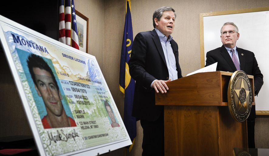 "Sen. Steve Daines, R-Mont., joined by Montana Attorney General Tim Fox, right, discusses Montana's noncompliance with the federal REAL ID Act during a press conference showing the state's new driver's license at the attorney general's office, Thursday, Jan. 7, 2016, in Helena, Mont. Fox says that enhanced security measures included in Montana's new driver's licenses are not meant to comply with federal standards he says could create an ""Orwellian national ID system."" (Thom Bridge/Independent Record via AP) MANDATORY CREDIT"