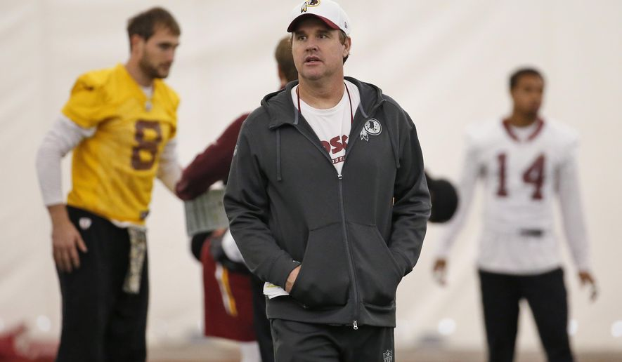 Washington Redskins head coach Jay Gruden walks on the field during practice at the team's NFL football training facility at Redskins Park, Thursday, Jan. 7, 2016 in Ashburn, Va. The Washington Redskins will play the Green Bay Packers in a wild-card game on Sunday. (AP Photo/Alex Brandon)