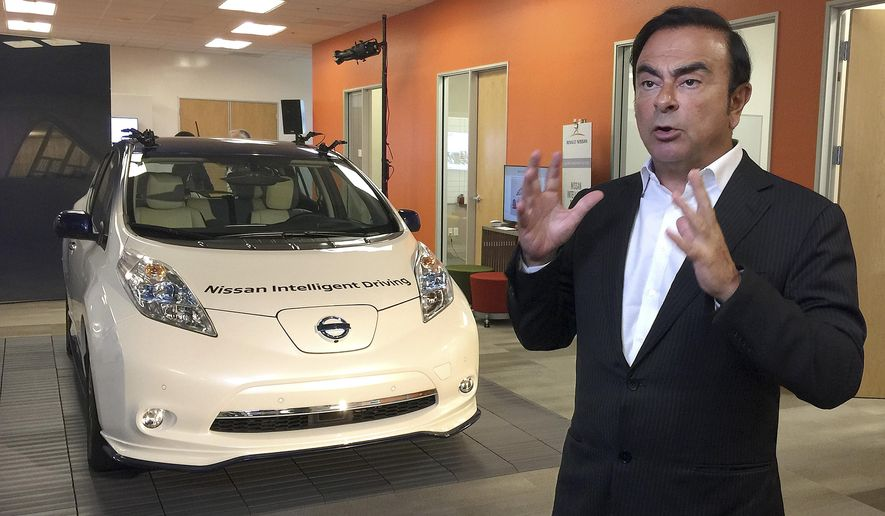 Carlos Ghosn, chairman and CEO of Nissan, speaks next to a prototype of the autonomous driving Nissan Leaf at Renault-Nissan Silicon Valley in Sunnyvale, Calif., Thursday, Jan. 7, 2016. The Renault-Nissan Alliance is entering the race to build autonomous cars with a plan to introduce 10 models capable of temporarily relieving humans of their driving duties on highways and city streets. (AP Photo/Terry Chea)