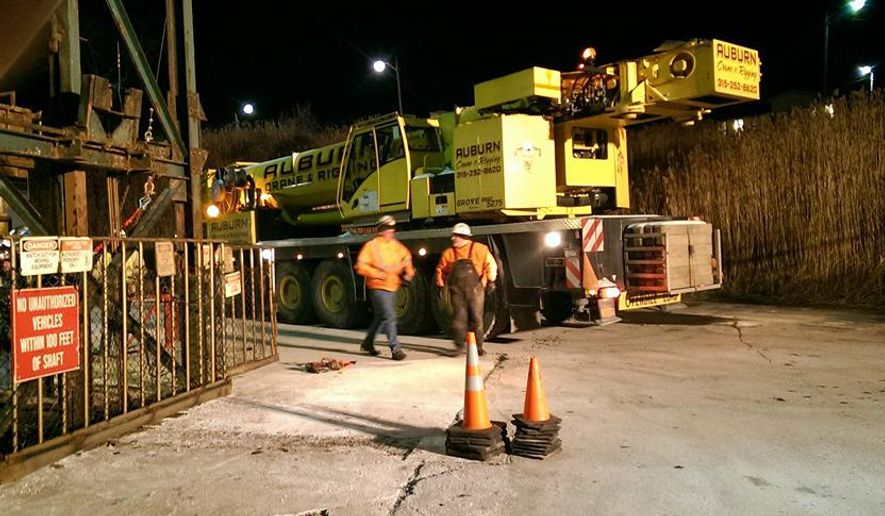 This photo provided by the Ithaca Fire Department shows a crane that will assist the rescue of seventeen miners stuck in an elevator underground at the Cargill Salt Mine in Lansing, N.Y., on Thursday, Jan. 7, 2016.   Tompkins County Emergency Management officials say the miners have been trapped since late Wednesday night at the mine, about 40 miles outside Syracuse, and are not in any danger.  (Ithaca Fire Department via AP)