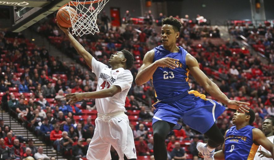 San Diego State guard Jeremy Hemsley scores after beating San Jose State guard Princeton Onwas on a breakaway during the first half of a NCAA college basketball game Wednesday, Jan. 6, 2016, in San Diego.  (AP Photo/Lenny Ignelzi)