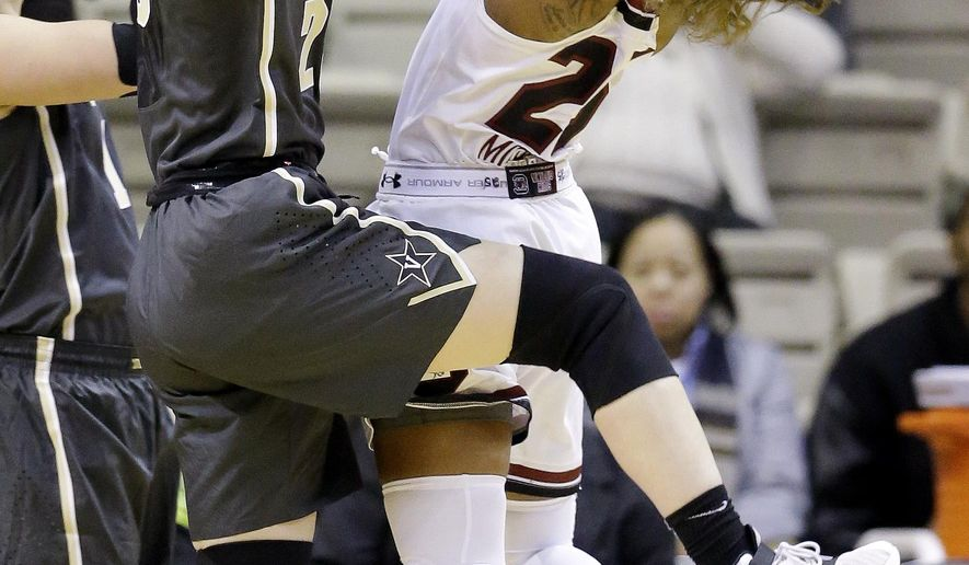 South Carolina guard Tiffany Mitchell, right, shoots against Vanderbilt guard Minta Spears during the first half of an NCAA college basketball game Thursday, Jan. 7, 2016, in Nashville, Tenn. (AP Photo/Mark Humphrey)