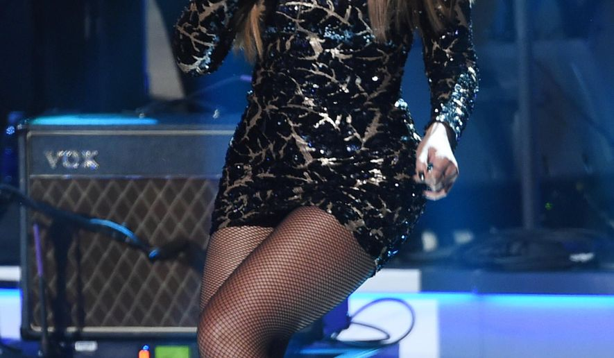 """FILE - In this Feb. 10, 2015 file photo, Beyonce performs at """"Stevie Wonder: Songs in the Key of Life - An All-Star Grammy Salute,"""" at the Nokia Theatre L.A. Live, in Los Angeles. Beyonce is returning to the Super Bowl halftime show. Pepsi confirmed to The Associated Press on Thursday, Jan. 7, 2016, that the 34-year-old singer will perform at the Feb. 7 show at Levi's Stadium in Santa Clara, Calif. (Photo by Chris Pizzello/Invision/AP, File)"""