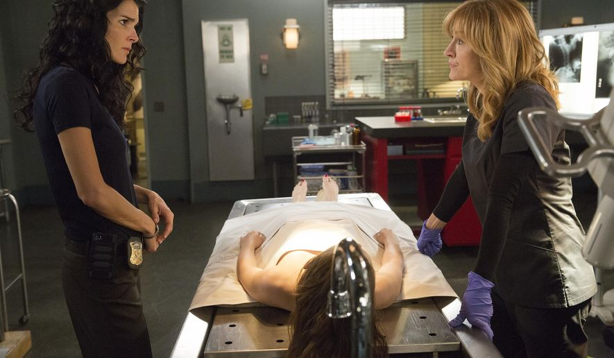 "This image released by TNT shows Angie Harmon, left, and Sasha Alexander in a scene from "" Rizzoli & Isles."" TNT is ending the crime drama ""Rizzoli & Isles"" after its seventh season this summer. (Doug Hyun/TNT via AP)"