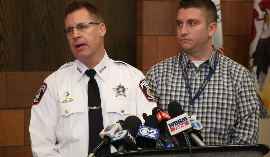 Zion Police Chief Stephen Dumyahn, left, speaks as Lake County Major Crime Task Force Detective Christopher Covelli listens during a news conference after a police involved shooting in Zion, Ill., Wednesday, Jan. 6, 2016. Covelli said officers dispatched to north suburban Zion for a suspicious person Wednesday morning began chasing the man on foot and a struggle ensued in which the man was shot. He was pronounced dead at a Waukegan hospital. (Gilbert R. Boucher II/Daily Herald via AP) MANDATORY CREDIT; MAGS OUT, TV OUT