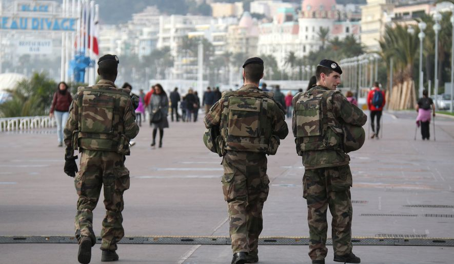 French soldiers patrol on the Promenade des Anglais in Nice, southeastern France, Friday, Jan. 8, 2016. It's a year since an attack on the French satirical newspaper Charlie Hebdo launched a bloody year in Paris. Tensions in France, under a state of emergency since a wave of attacks on Nov. 13, have been even higher this week as the anniversary of the January attacks approached. (AP Photo/Lionel Cironneau)