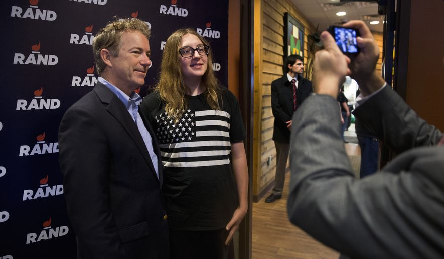 Republican presidential candidate, Sen. Rand Paul, R-Ky. poses with supporter Dalton Reber during a campaign event at a restaurant, Friday, Jan. 8, 2016, in Ottumwa, Iowa. (AP Photo/Jae C. Hong)