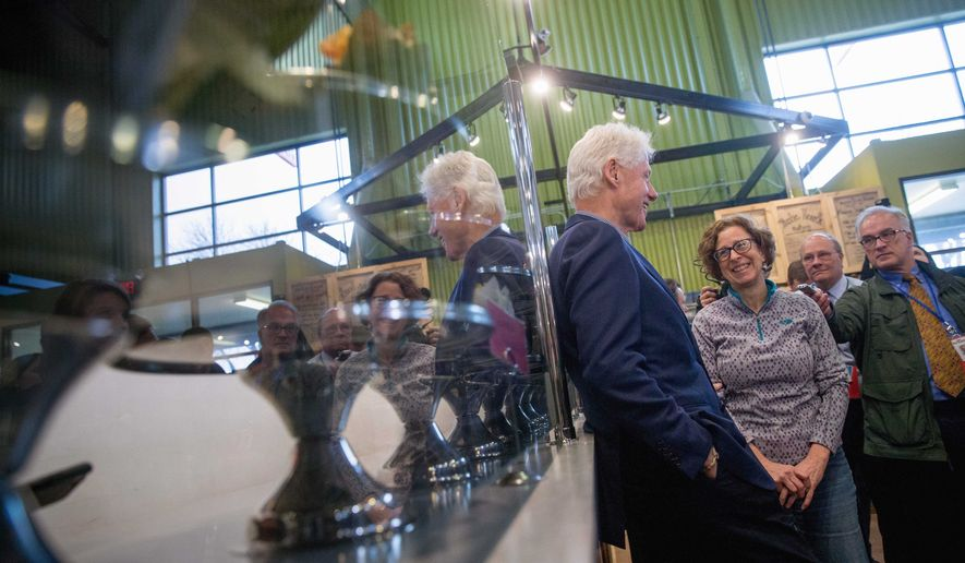 Former President Bill Clinton speaks with visitors to the Newbo City Market in Cedar Rapids, Iowa, Thursday, Jan. 7, 2016, before speaking at a campaign stop for his wife Democratic presidential candidate Hilary Clinton at the National Czech & Slovak Museum in Cedar Rapids. (AP Photo/Andrew Harnik)