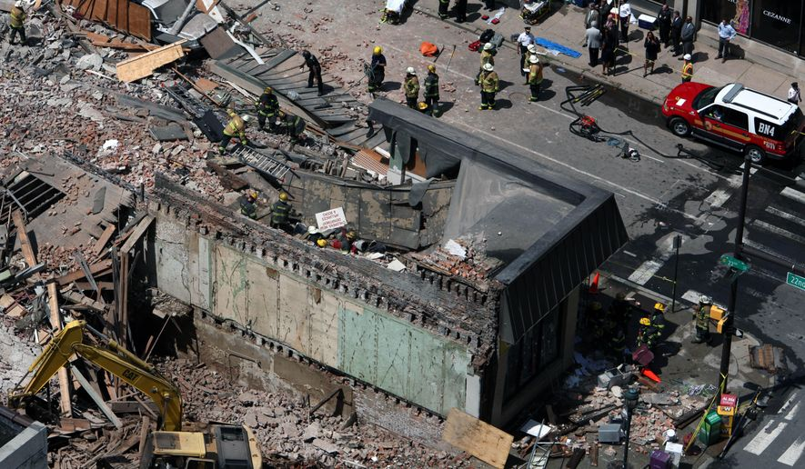 FILE - In this June 5, 2013, file photo, rescue personnel work the scene of a building collapse on Market Street in downtown Philadelphia that left six people dead. Two demolition contractors are schedule to be sentenced on Friday, Jan. 8, 2016 for the collapse. (AP Photo/Jacqueline Larma, File)