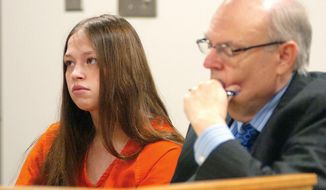 FILE - In this Aug. 26, 2015 file photo, Brittany Pilkington, left, appears for arraignment on three capital murder charges with her attorney Marc S. Triplett in Logan County Common Pleas Court in Bellefontaine, Ohio. Attorneys for Pilkington accused of suffocating her three sons out of jealousy over attention her husband paid them want the prosecutor's office removed from the case for interrogating her without her lawyer present.  (Joel E. Mast/The Examiner via AP, File) MANDATORY CREDIT