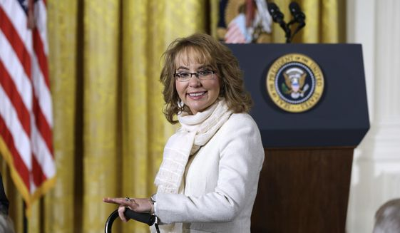 In this file photo from Tuesday, Jan. 5, 2016,  former Arizona Rep. Gabby Giffords arrives in the East Room of the White House in Washington to hear President Obama speak about steps his administration is taking to reduce gun violence. In past five years, Giffords has hiked the Grand Canyon, raced in a 40-mile bike ride, sky dived and founded an advocacy group that helped convince President Obama to take executive action on gun control. (AP Photo/Carolyn Kaster)