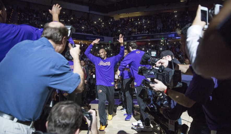Los Angeles Lakers guard Kobe Bryant, center, is introduced before the team's NBA basketball game against the Sacramento Kings in Sacramento, Calif., Thursday, Jan. 7, 2016. (AP Photo/Carl Costas)