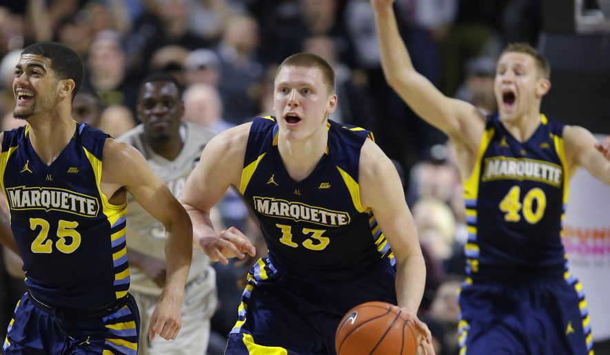 FILE - In this Jan. 5, 2016, file photo, Marquette forward Henry Ellenson (13) brings the ball up court after pulling in a defensive rebound after Providence guard Kris Dunn missed the final shot of the game as time runs out in the second half of their NCAA college basketball game, in Providence, R.I. Also seen celebrating are Marquette guard Haanif Cheatham (25) and center Luke Fischer (40). Marquette has had a roller coaster of a seaon so far in 2015-16. It might be just the kind of up and down ride expected for a team that relies heavily on freshmen, led by forward Henry Ellenson. (AP Photo/Stephan Savoia, File)