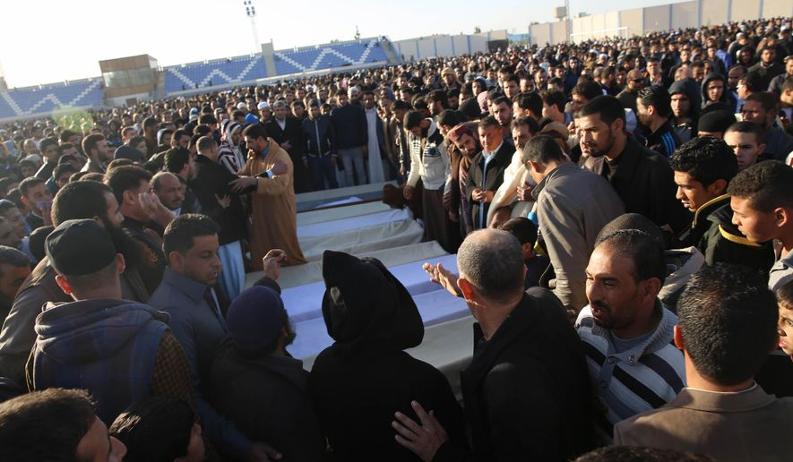 People attend a funeral of policemen killed in a truck bomb at a police base in the western Libyan town of Zliten on Thursday,Jan. 7, 2016.  A massive truck bomb exploded near a police base killing at least 60 policemen and wounding around 200 others, officials said. (AP Photo/Mohamed Ben Khalifa)