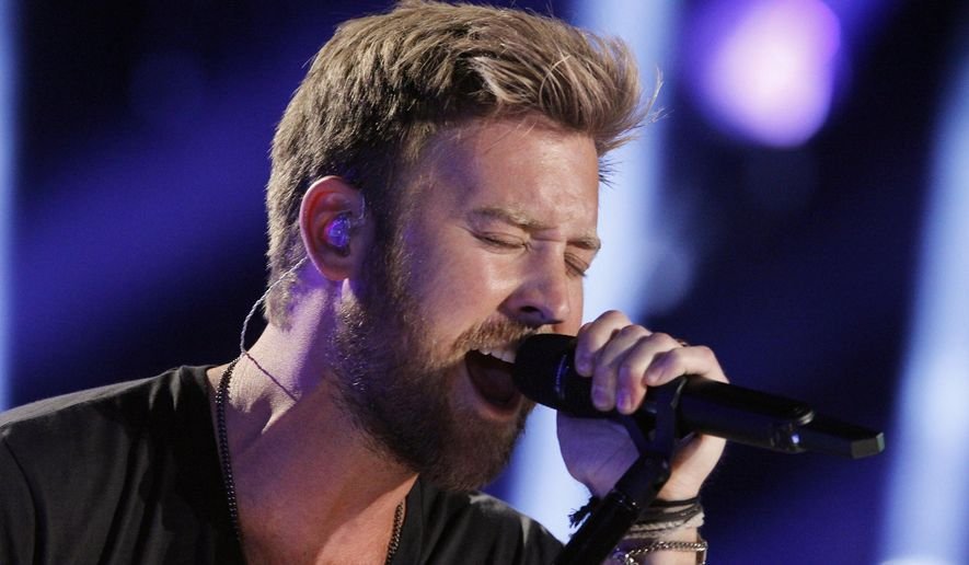 FILE - In this June 8, 2014, file photo, Charles Kelley of Lady Antebellum performs during the CMA Fest at LP Field in Nashville, Tenn. Kelley in February 2016 is expecting his first child and releasing his first solo record apart from the country vocal group Lady Antebellum. (Photo by Wade Payne/Invision/AP, File)