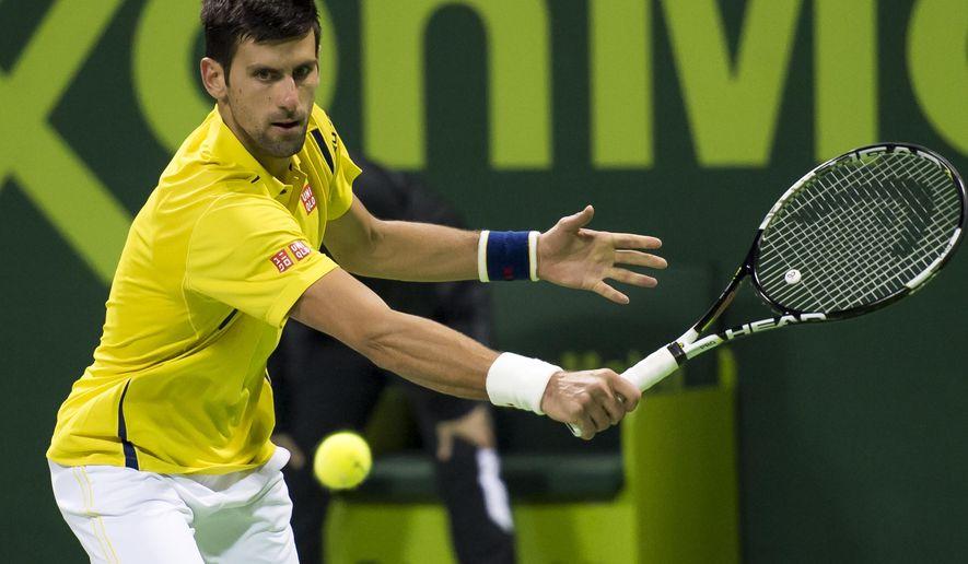 Serbia's Novak Djokovic returns the ball to Tomas Berdych of Czech Republic at the Qatar Open 2016 semifinal match in Doha, Qatar, Friday, Jan. 8, 2016. (AP Photo/Alexandra Panagiotidou)