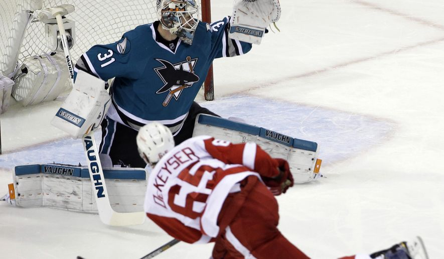 Detroit Red Wings' Danny DeKeyser (65) scores past San Jose Sharks goalie Martin Jones (31) during the first period of an NHL hockey game Thursday, Jan. 7, 2016, in San Jose, Calif. (AP Photo/Marcio Jose Sanchez)