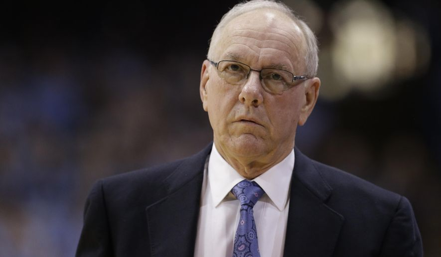 FILE - In this Jan. 26, 2015, file photo, Syracuse coach Jim Boeheim walks along the sidelines during the first half of an NCAA college basketball game against North Carolina in Chapel Hill, N.C. Boeheim returns from a nine-game NCAA suspension against No. 6 North Carolina on Saturday, Jan. 9, 2016, in Syracuse. (AP Photo/Gerry Broome)