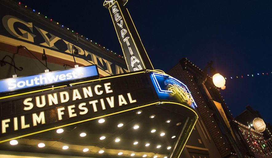 FILE - This Jan. 22, 2015 file photo shows the Egyptian Theatre on Main Street during the first day of  the 2015 Sundance Film Festival in Park City, Utah. Every January, the streets of the mountain town of Park City, Utah, light up as the Robert Redford-founded Sundance Film Festival pulls in big names to introduce future Oscar winners and eye-opening documentaries. Tickets for many screenings during the festival that starts Jan. 21, 2016, are publicly available, and there are ways to get in on the action and still have some cash left over for popcorn. (Photo by Arthur Mola/Invision/AP, File)