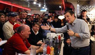 FILE - In this Jan 4, 2016 file photo, Republican Presidential candidate, Sen. Ted Cruz, R-Texas, campaigns at Penny's Diner in Missouri Valley, Iowa. Tea party flame-thrower Ted Cruz is showing voters his softer side during his presidential campaign in Iowa, whether through his joke-laced stump speech or one-on-one interactions.  (AP Photo/Nati Harnik, File)