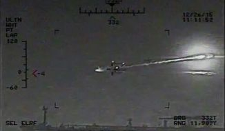 "This image made from video released by the U.S. Navy on Saturday, Jan. 9, 2016 shows the view from a Seahawk helicopter in the Strait of Hormuz on Dec. 26, 2015. The U.S. Navy says the video shows a rocket fired from an Iranian Revolutionary Guard vessel near warships and commercial traffic in the strategic strait. What appears to be an oil tanker is seen in the foreground. Previously an Iranian Revolutionary Guard spokesman had denied conducting any naval drills at the time and called the American accusations ""psychological warfare."" (U.S. Navy via AP)"