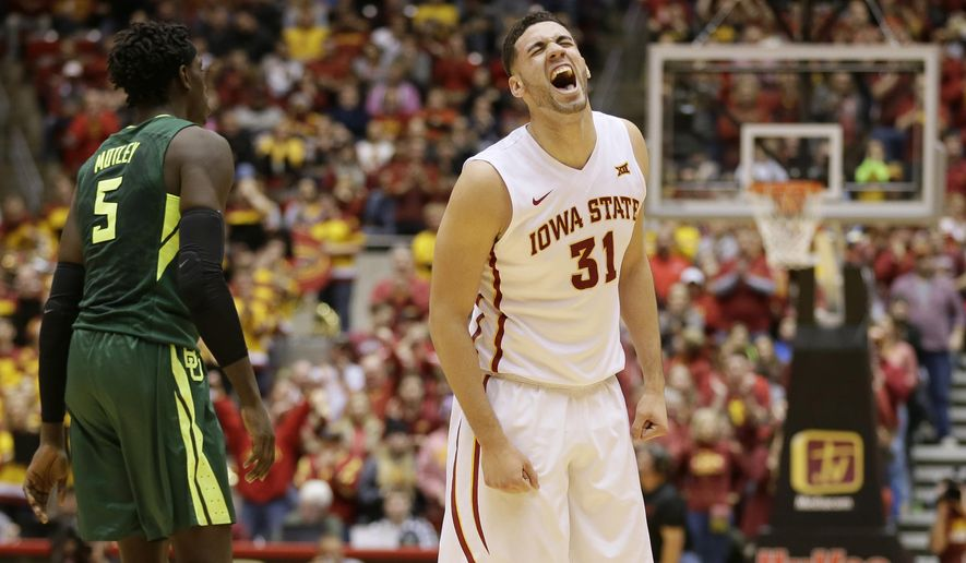 Iowa State forward Georges Niang (31) celebrates in front of Baylor forward Johnathan Motley, left, after making a 3-point basket during the first half of an NCAA college basketball game, Saturday, Jan. 9, 2016, in Ames, Iowa. (AP Photo/Charlie Neibergall)