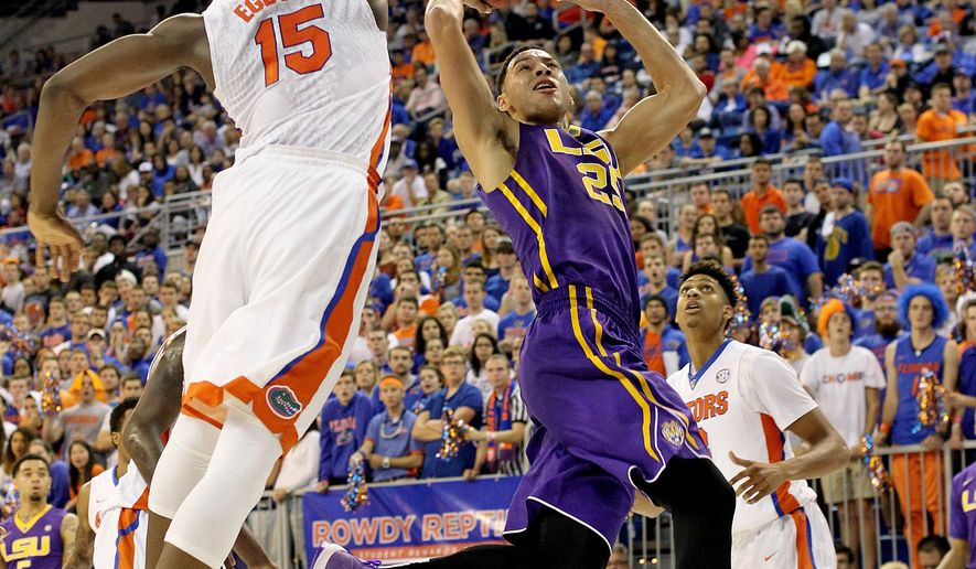 LSU forward Ben Simmons (25) takes a shot before being fouled by Florida center John Egbunu (15) during the first half of an NCAA college football game, Saturday, Jan. 9, 2016, in Gainesville, Fla. (Matt Stamey/The Gainesville Sun via AP)  THE INDEPENDENT FLORIDA ALLIGATOR OUT; MANDATORY CREDIT